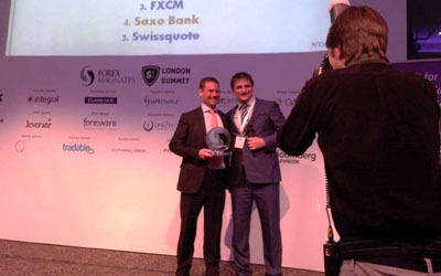 Saxo Bank's Kim Fournais being presented with the Forex Magnates Award for Best Broker by Michael Greenberg